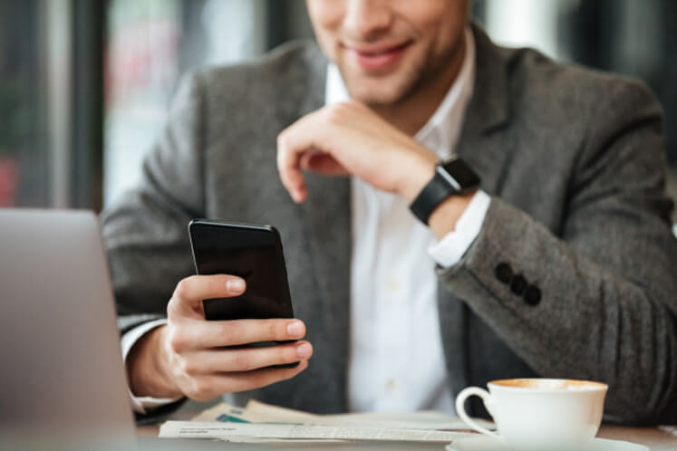 Man using simple contact manager on phone
